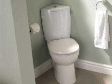 Угловой унитаз с бачком: практичная возможность экономия места в небольшом туалете